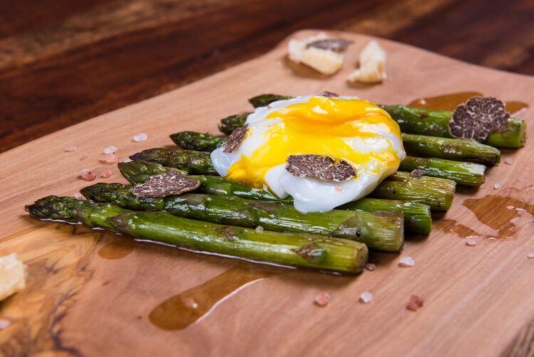 Eggs Benedict on asparagus and truffles