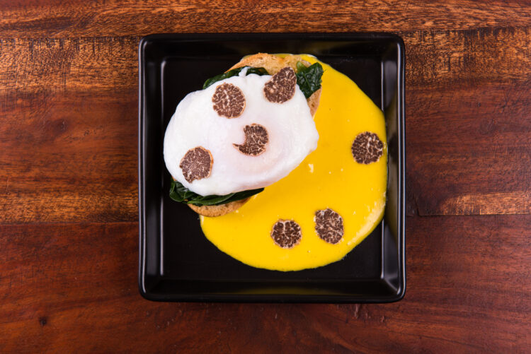 Eggs Benedict with spinach, white truffles and holland sauce